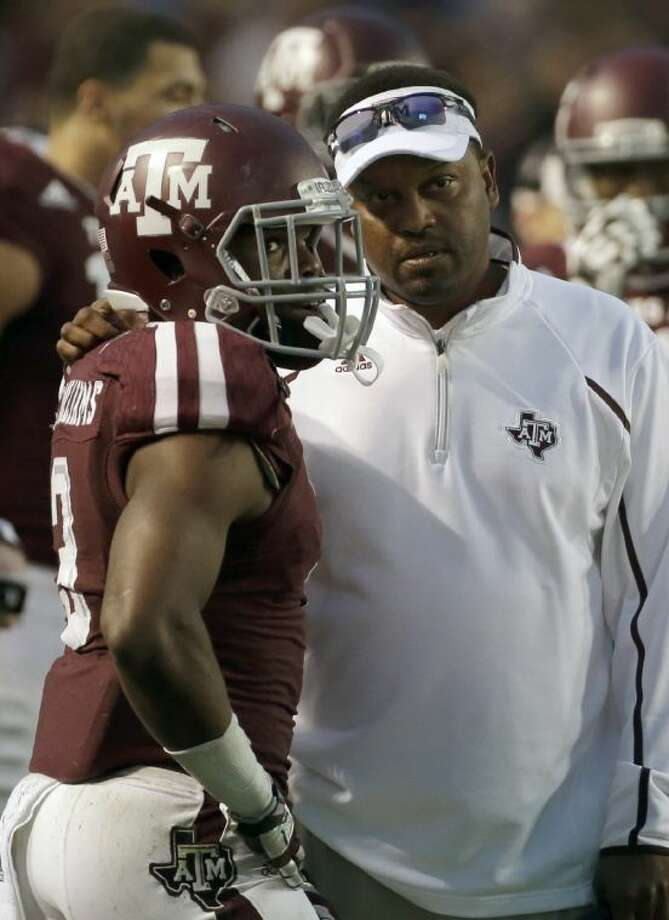 Texas A&M coach Kevin Sumlin, hear talking to the Aggies' Trey Williams, leads his team against No. 5 Missouri tonight in Columbia, Mo. Photo: David J. Phillip