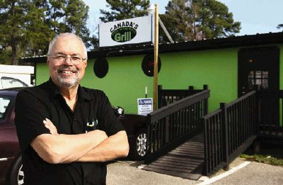 Restaurateur James Canada opened his new Hole in the Wall Grill in Conroe Wednesday.