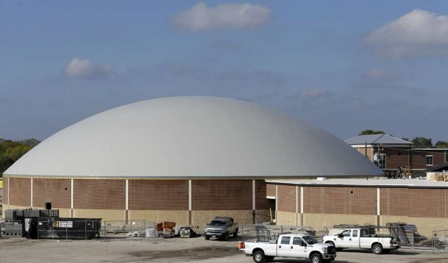 In this Dec. 6 photo, work continues on the construction of a new domed gym at Edna High School in Edna, Texas. The hurricane dome, a structure being built in part with money from the Federal Emergency Management Agency, can be used to house first responders or residents evacuated during a storm. Photo: David J. Phillip