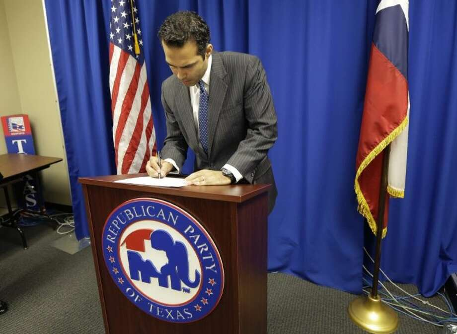 In this Nov. 19 file photo, George P. Bush, the grandson of one former president and nephew of another, signs papers at the Republican Party of Texas headquarters in Austin, where he formally filed to run for Texas land commissioner. In a sharp pivot from a decade of Republican swagger in Texas, a bravado that comes with controlling every statewide office, conservatives are muffling mocking tones about Democrats and now openly calling them formidable.