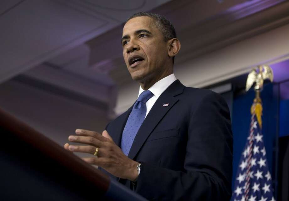 President Barack Obama delivers a statement on the fiscal cliff negotiations with congressional leaders in the briefing room of the White House on Friday in Washington. Photo: Evan Vucci