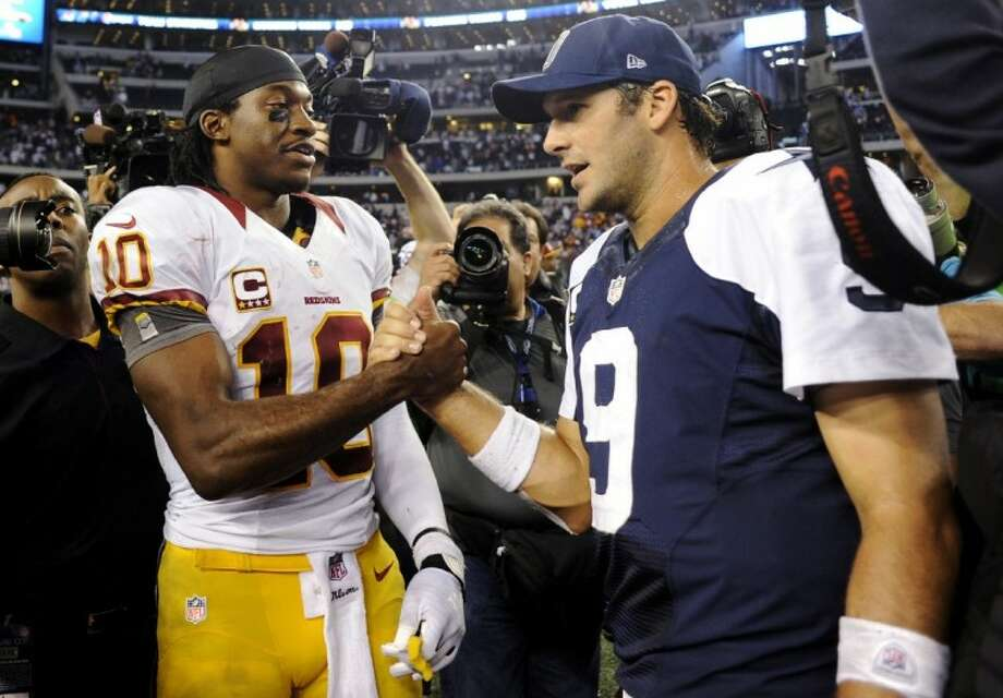 Cowboys quarterback Tony Romo, right, and the Redskins' Robert Griffin III will be center stage in tonight's game in Landover, Md. Photo: Matt Strasen