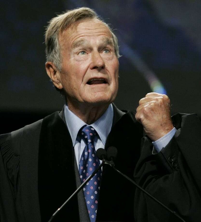 In this Sept. 21, 2006 file photo, former President George H.W. Bush delivers the keynote speech before receiving an honorary Doctor of Public Administration degree at Suffolk University in Boston. A spokesman says Bush's condition continues to improve and that he was moved Saturday, Dec. 29, 2012, out of intensive care and into a regular hospital room. Photo: Elise Amendola