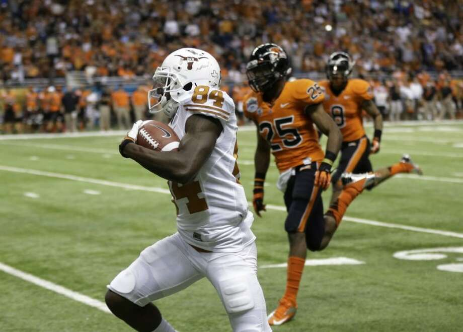 Texas' Marquise Goodwin runs for a 64-yard touchdown during the second quarter of the Alamo Bowl. Photo: Eric Gay