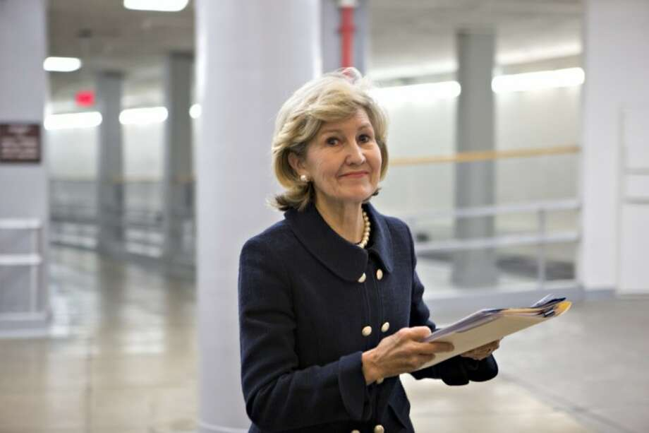 "After nearly two decades as the first woman to represent Texas in the U.S. Senate, Sen. Kay Bailey Hutchison, R-Texas, walks to the floor of the Senate on Capitol Hill in Washington Dec. 12 to give her farewell speech. In the chamber, Sen. Hutchison became emotional as she recalled her ""Homemaker's IRA"" legislation which gave homemakers — men and women — the same rights to establish an Individual Retirement Account, or IRA, as their working spouses. Photo: J. Scott Applewhite"