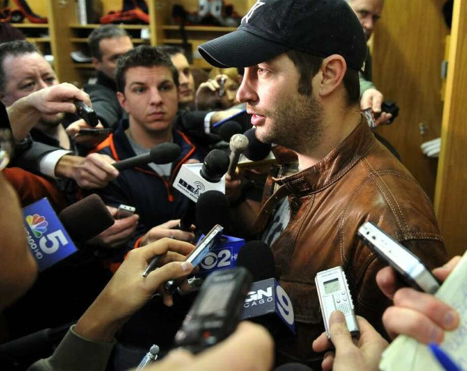 Chicago Bears quarterback Jay Cutler answers questions after learning his coach, Lovie Smith, had been fired. The Bears started the season 7-1 but finished 10-6 and missed the playoffs. Photo: Al Podgorski