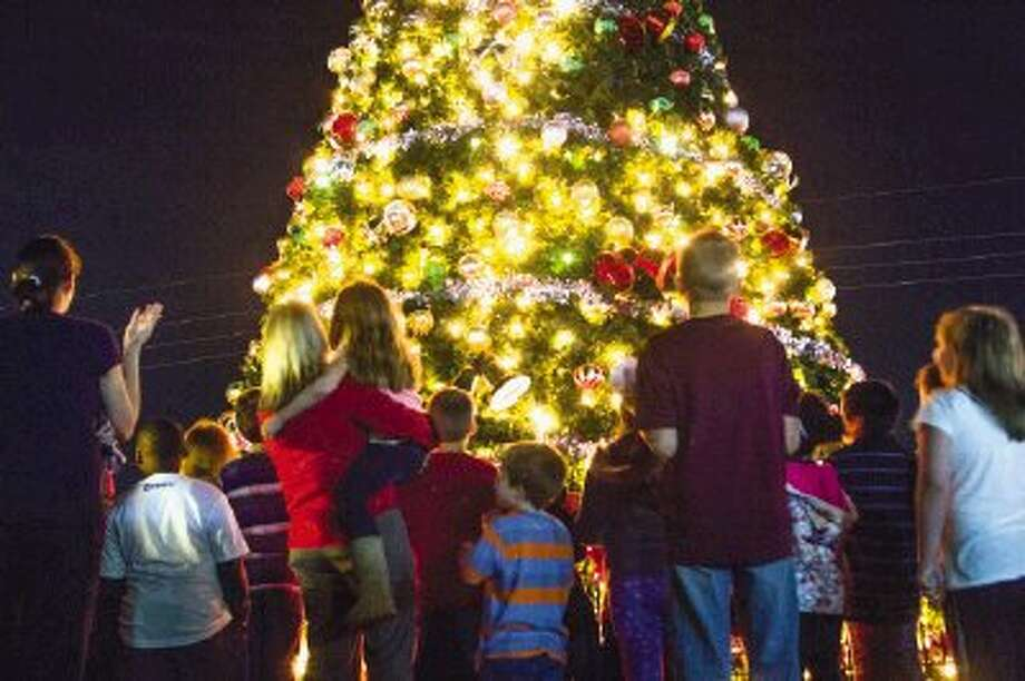 People gather for a tree lighting at Heritage Place in downtown Conroe on Tuesday night. Photo: Staff Photo By Ana Ramirez / The Conroe Courier