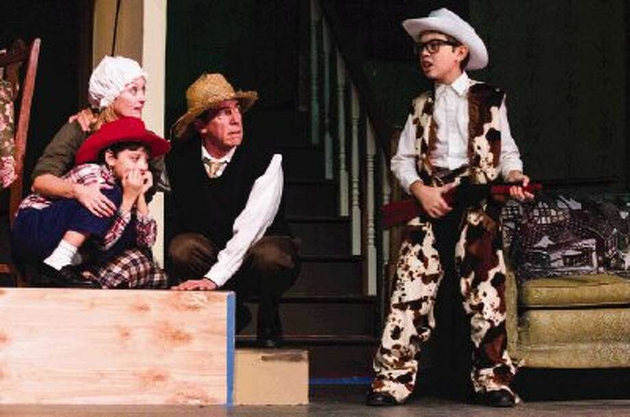 """From left, Patrice Kentimenos, Robben Montez,Todd Brady and Ian Montez play the main family Stage Right's """"A Christmas Story""""at the Crighton Theatre. The play will show from Dec. 6 - 22. Photo: Staff Photo By Ana Ramirez / The Conroe Courier"""