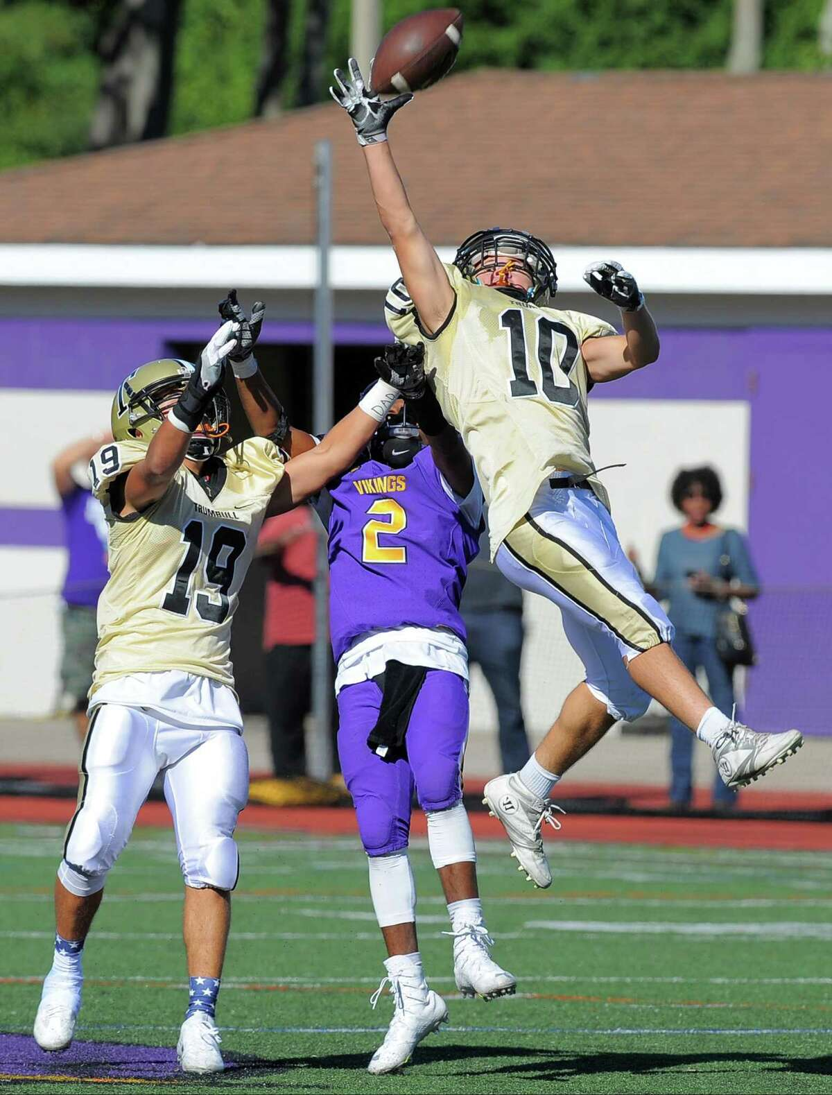Trumbull Dustin Siqueira and Zach Heche break up the pass intended for Westhill Noldylens Metayerin during second half football action on Saturday, Sept. 24, 2016 in Stamford, Connecticut. Trumbull defeated Westhill 48-19.