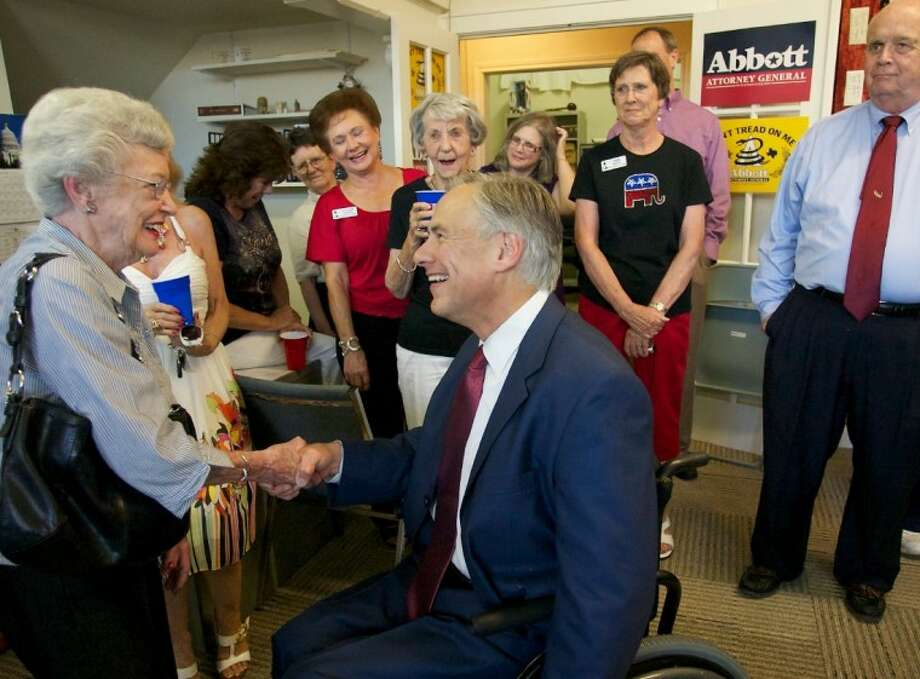 Texas Attorney General Greg Abbott shakes hands with supporter Kyle Harding during a meet and greet Wednesday at the Montgomery County Republican Headquarters in Conroe. Photo: Staff Photo By Eric Swist
