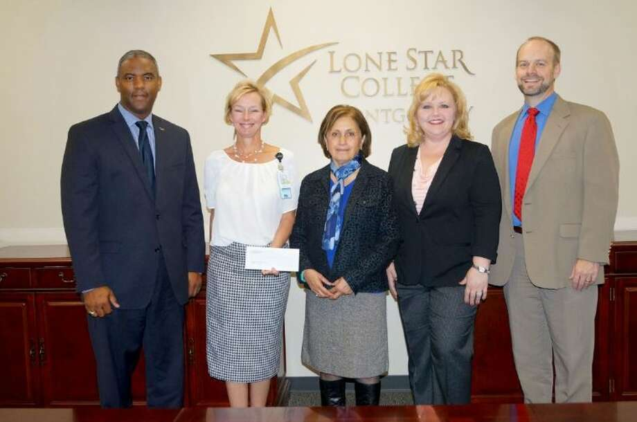 Officials from Memorial Hermann The Woodlands Hospital recently presented a check to the Lone Star College-Montgomery nursing program to fund a faculty position and allow the college's nursing program to continue to expand, meeting the critical need for nurses in the area. Pictured (left to right) are Dr. Austin Lane, president of Lone Star College-Montgomery; Tami Herschmann RN, MSN, CNOR, interim chief nursing officer, Memorial Hermann The Woodlands; Manijeh Scott, director of nursing, Lone Star College-Montgomery; Jody Collins, MSN, RN, director, Magnet program and staff development, Memorial Hermann The Woodlands; and Mike Krall, academic dean for the natural sciences and health professions division at Lone Star College-Montgomery. Photo: LaNae Ridgwell