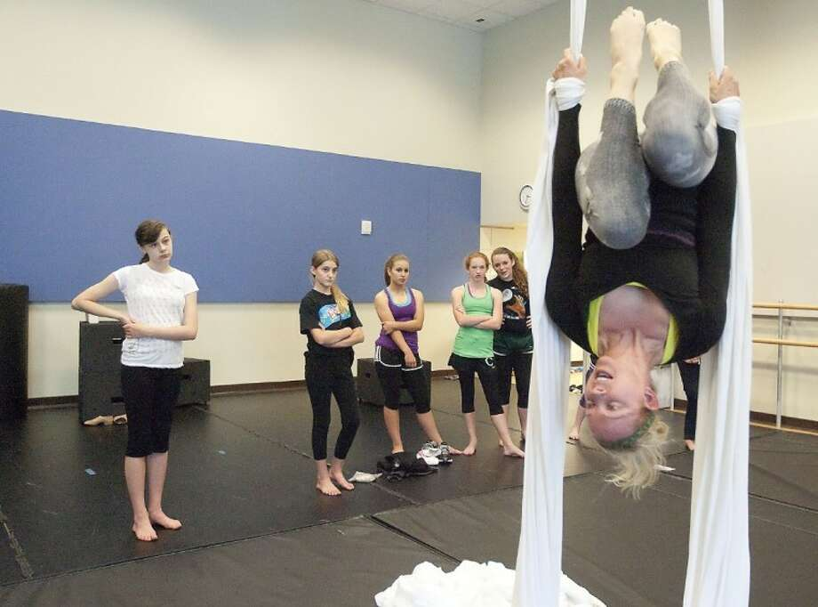 Jill Crook demonstrates silk aerial techniques to dance students Friday at the John Cooper School. Photo: Karl Anderson