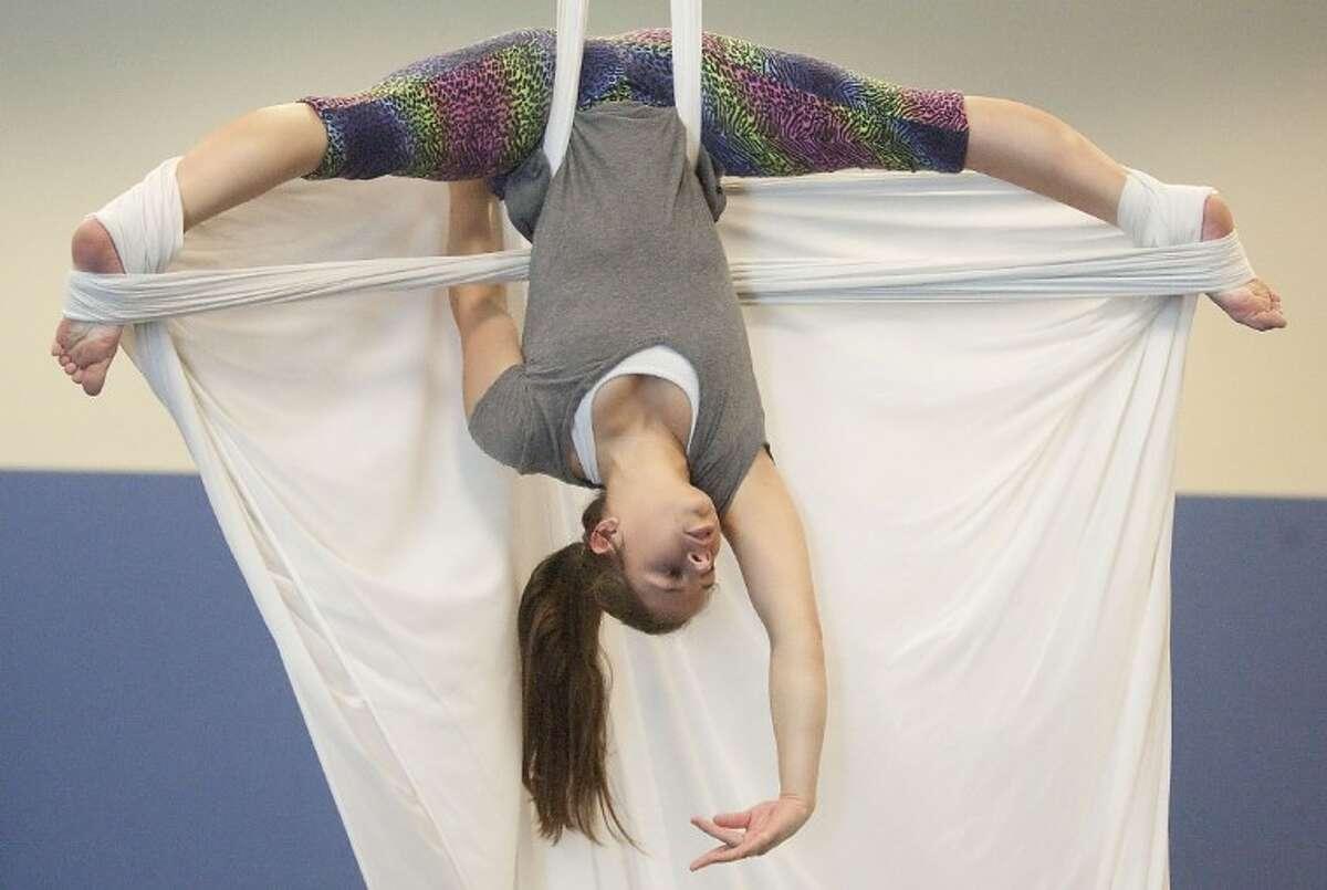 Lauren Katterhagen practices silk aerial techniques Friday at the John Cooper School.