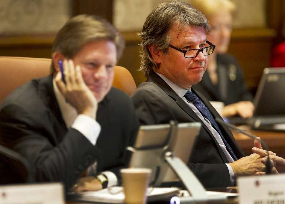 Regent Wallace L. Hall Jr., right, listens to the topic of discussion at the UT System Board of Regents meeting Thursday.