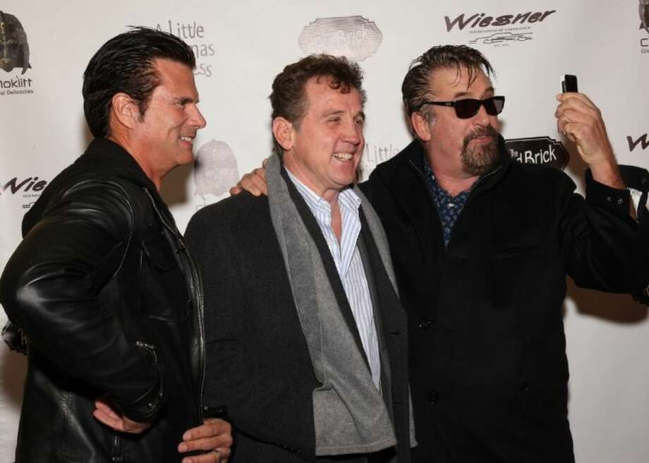 "From left, actor Lorenzo Lamas, Director Chuck Walker, of Conroe and actor Daniel Baldwin pose for a photo during this month's red carpet-premiere of ""A Little Christmas Business,"" a movie made in and around Conroe by WalkerCable Productions."