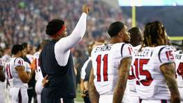 Texans offensive lineman Duane Brown raises his fist in protest during the national anthem before the game Thursday night in New England.