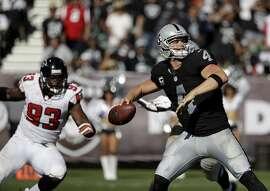 Oakland Raiders quarterback Derek Carr (4) passes against the Atlanta Falcons during the second half of an NFL football game in Oakland, Calif., Sunday, Sept. 18, 2016. (AP Photo/Marcio Jose Sanchez)