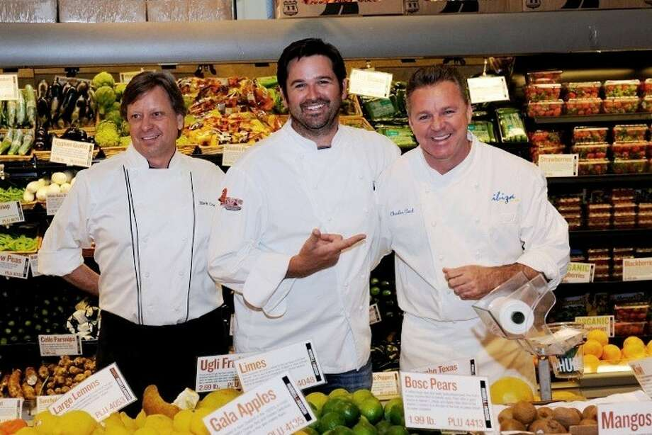 Pictured, from left, are Chef Mark Cox of MARK'S American Cuisine, Chef Bryan Caswell of REEF, and Chef Charles Clark of Ibiza Food & Wine Bar.