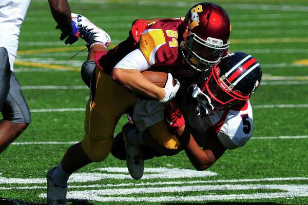 St. Joseph's Charlie Pagliarini is tackled by Brien McMahon's Chandler Greene during football action in Trumbull, Conn., on Saturday Sept. 24, 2016.
