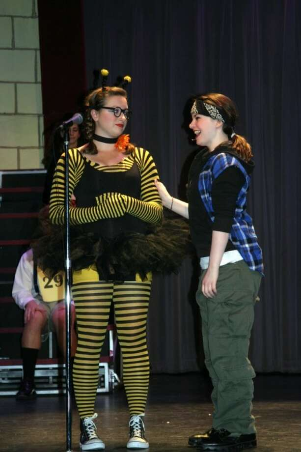 """Madison Cagle, who played """"Comfort Counselor Midge,"""" and one of the """"Bees"""" perform in the John Cooper School's production of the Finn's """"25th Annual Putnam County Spelling Bee,"""" which ran Nov. 18-21."""