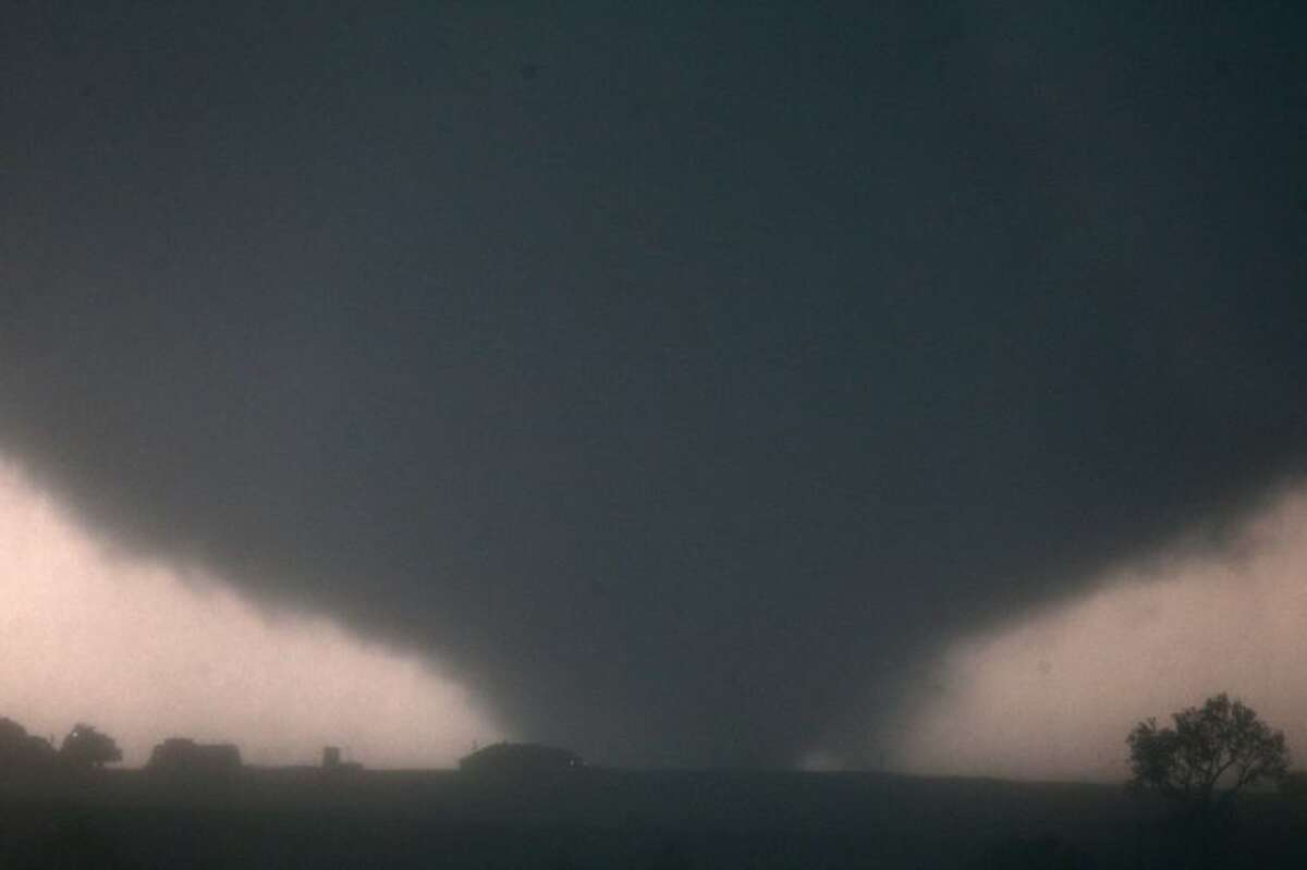 A tornado touches down near El Reno, Okla., Friday, causing damage to structures and injuring travelers on Interstate 40.