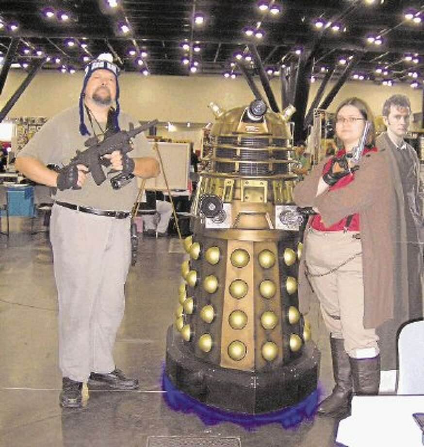 """From left Larry Evans II, a Dalek, one of the classic alien monsters from Dr. Who and Elizabeth Evans. Larry Evans II was dressed as Jayne Cobb from Joss Whedon's """"Firefly"""" and Elizabeth Evans was dressed as Capt. Mal Reynolds, also from """"Firefly."""" Elizabeth Evans is a summer intern at The Courier and attended the 2013 Comicpalooza with her family over Memorial Day weekend. / Copyright 2003-2004"""