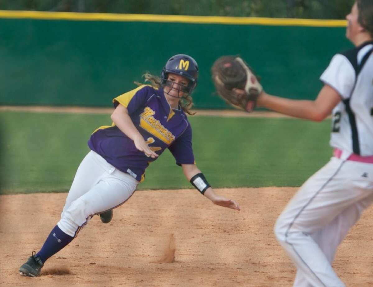 Montgomery's Kameron Poppell slides safely into third base during Saturday's Region III-4A area-round playoff game against Nederland.
