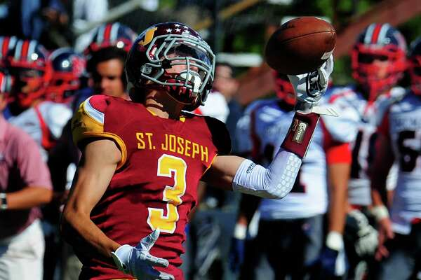 St. Joseph's Jared Mallozzi regains control of the ball on his way to the end zone for one his four TD catches.