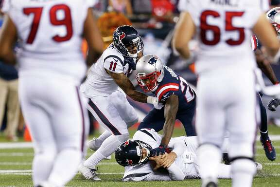 New England Patriots cornerback Cyrus Jones (24) tackles Houston Texans quarterback Brock Osweiler (17) during the fourth quarter of an NFL football game at Gillette Stadium on Thursday, Sept. 22, 2016, in Foxborough, Mass. ( Brett Coomer / Houston Chronicle )