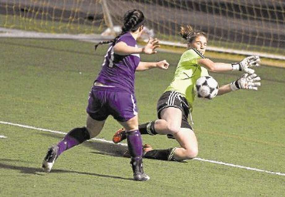 Conroe goalkeeper Lauren Young stops a shot by Lufkin midfielder Shelby Smitherman (11) during a match at Buddy Moorhead Memorial Stadium on Tuesday. To view or purchase this photo and others like it, visit HCNpics.com. Photo: Jason Fochtman / @WireImgId=2617029