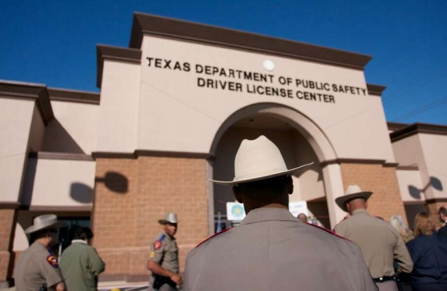 A Texas Department of Public Safety trooper is seen in front of the new Texas DPS Spring Drivers License Mega Center at 4740 Spring Cypress Road. Photo: Staff Photo By Eric Swist