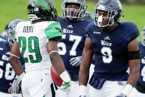 Rice Owls linebacker Tabari McGaskey (9) gets in the face of North Texas Mean Green running back Willy Ivery (29) on the sideline during the NCAA football game between the North Texas Mean Green and the Rice Owls at Rice Stadium in Houston, TX on Saturday, September 24, 2016.  The Owls lead the Mean Green 17-14 at halftime.