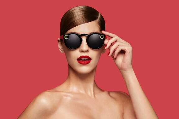 "This undated image courtesy of Snap Inc. shows the company's Spectacles video-catching sunglasses. Snapchat announced on September 24, 2016, it will launch a line of sunglasses, a spin on Glass eyewear abandoned by Google more than a year ago. The California-based company said in an online post that its Spectacles will be ""available soon,"" with media reports pegging the price at $130 a pair.  / AFP PHOTO / Snap Inc. / HO / RESTRICTED TO EDITORIAL USE - MANDATORY CREDIT ""AFP PHOTO / SNAP INC."" - NO MARKETING NO ADVERTISING CAMPAIGNS - DISTRIBUTED AS A SERVICE TO CLIENTS  HO/AFP/Getty Images"