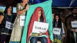 """Sakina Godhreya, center, plays the role of an abused woman during a skit put on by the San Antonio group AWAAZ, which means """"voice"""" in Hindi, during the Eid Festival 2016 on Saturday, September 24, 2016 at La Villita in San Antonio, Texas."""