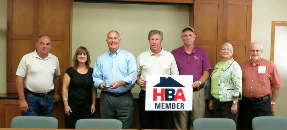Congressman John Moolenaar was presented with the National Association of Home Builders Defender of Housing Award recently at his office. Joining Moolenaar were Louis Pomaville, Jodi Sasse, Moolenaar, Matt Bader, Bruce Frost, Connie Frost and Jim Reichard, representing Bay, Central and Midland Home Builders Associations.