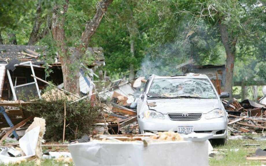 Officials with the Montgomery County Fire Marshal's Office and the Texas Railroad Commission are investigating the explosion at a Dobbin home Tuesday morning that critically injured two woman and a baby. Photo: Eric S. Swist