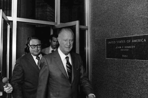 08/09/1971 - Houston banker and insurance company manager Frank Sharp, right, with his attorney Jerry G. Hill behind him leave the Federal Courthouse in Houston following a deposition session.
