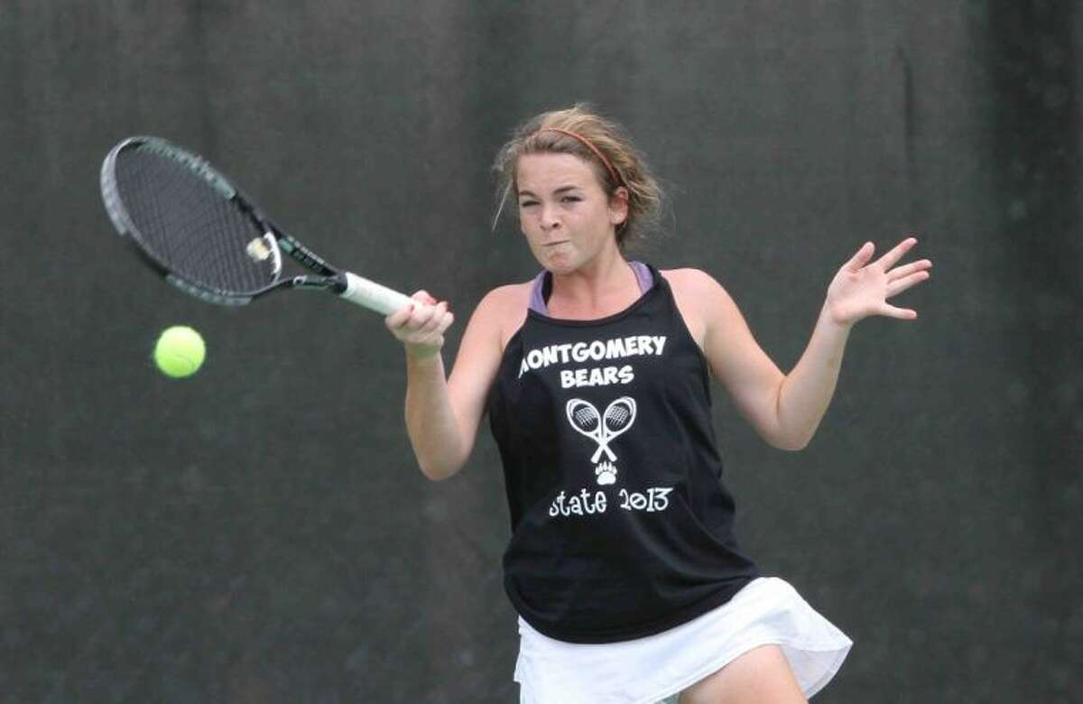 Montgomery's Dana Glaser competes in the Class 4A girls double quarterfinals with teammate Erika Richarme. Boerne Champion defeated Montgomery to advance to the semifinals. Go to HCNPics.com to view and purchase this photo, and others like it.