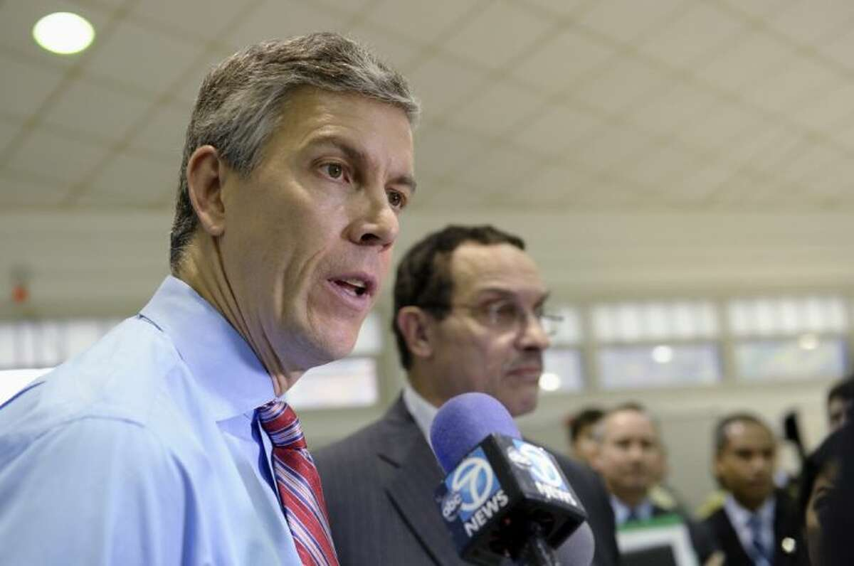 Education Secretary Arne Duncan, left, stands with Washington Mayor Vincent Gray, as he speaks to reporters during a visit to Malcolm X Elementary School in Washington Thursday. Today's fourth and eighth graders are doing better than their predecessors in math and reading, but despite record high scores it's too soon to start celebrating. The vast majority of students still are not demonstrating solid academic achievement in either subject, according to the Nation's Report Card, released Thursday.