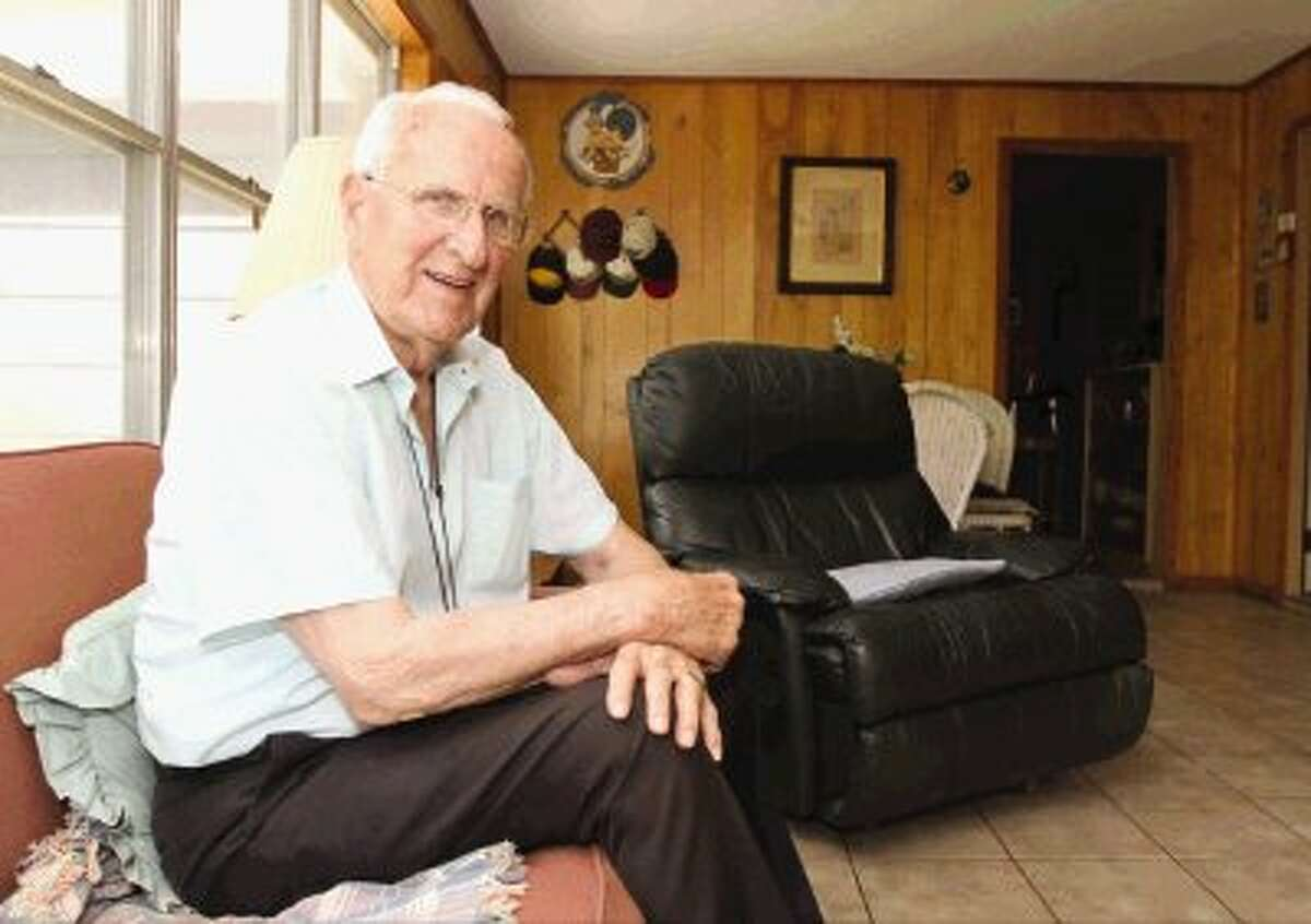 CK Ray poses for a photo at his home in Conroe. Ray retired from the Conroe Parks and Recreation Board and was named an ex-officio member.