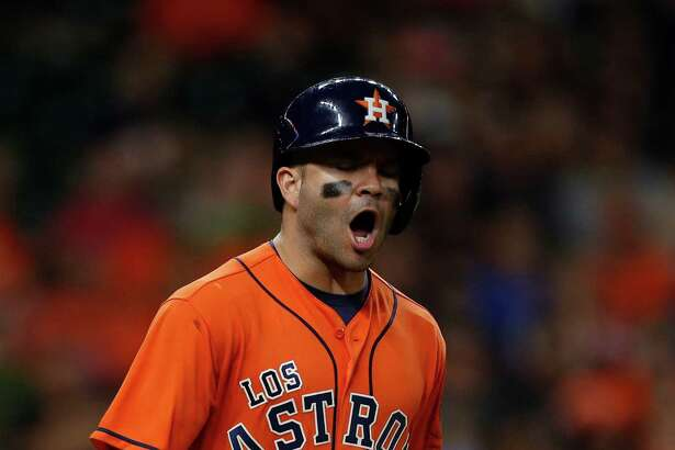 Houston Astros Jose Altuve (27) reacts after flying out during the fifth inning of an MLB game at Minute Maid Park, Saturday, Sept. 24, 2016 in Houston.