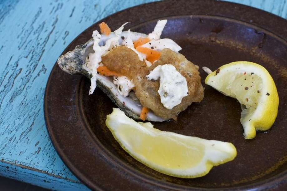 Pictured in this photo is a 'Fried' Guinness battered oyster with mustard pickle sauce. Photo: MATTHEW MEAD
