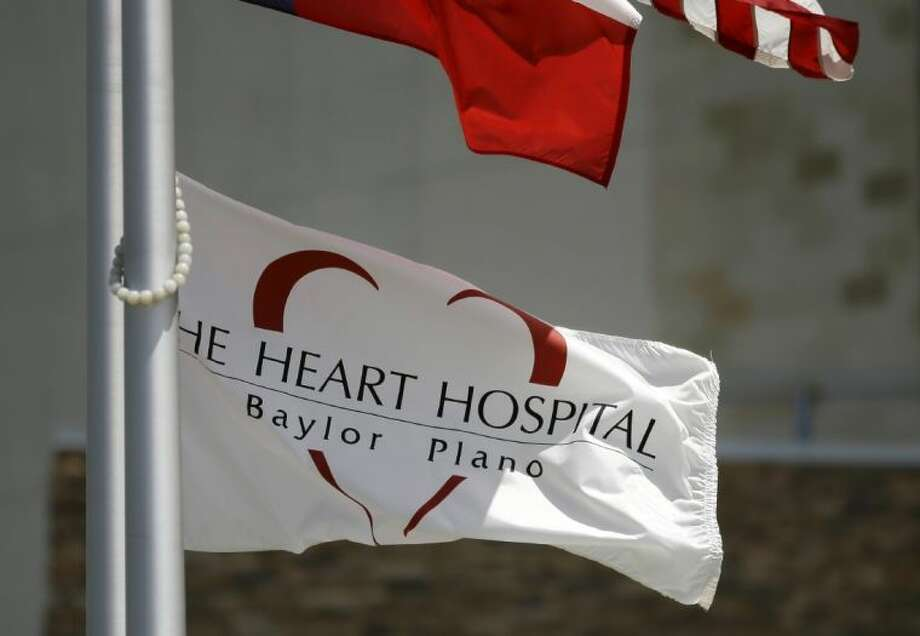 A flag with the branding, The Heart Hospital Baylor Plano, waves on a flag pole in front of the hospital Thursday in Plano. Photo: Tony Gutierrez