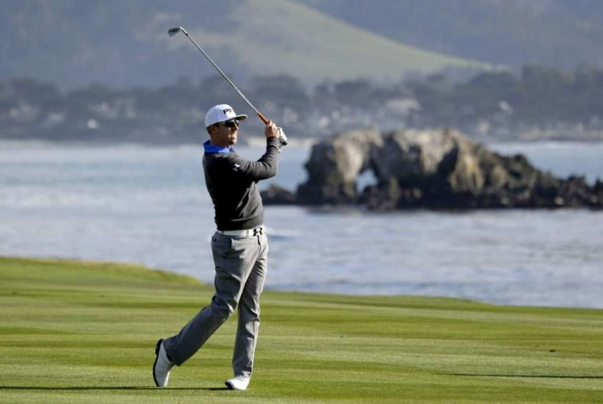 Hunter Mahan hits from the fairway on the 18th hole of the Pebble Beach Golf Links during the first round of the AT&T Pebble Beach Pro-Am on Thursday in Pebble Beach, Calif.