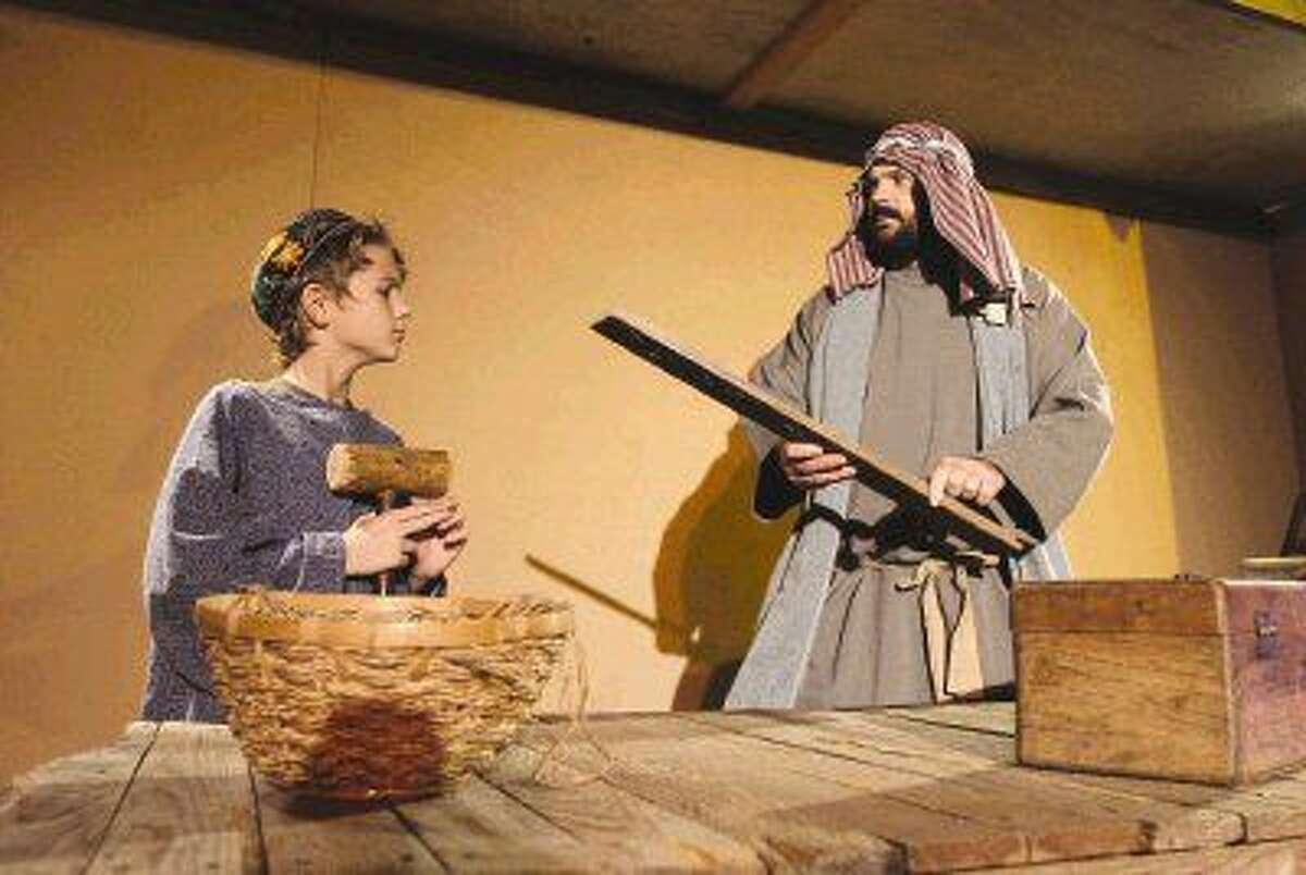 Todd Crabtree, right, goes through a scene with his son Nate during a rehearsal for Bethlehem City at West Conroe Baptist Church last December. The event, where more than 100 actors re-enact scenes from Jesus' life, is held every December as a gift to the community.