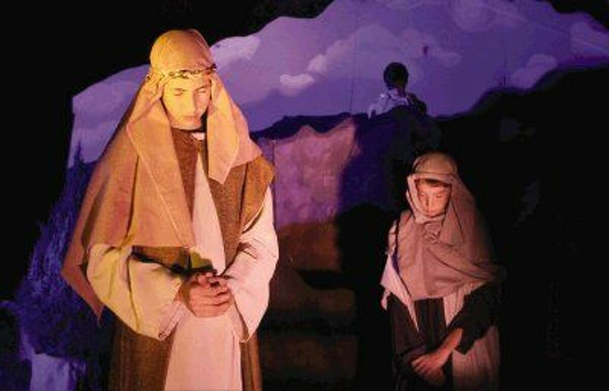 """Actors pray before a rehearsal for """"Bethlehem City"""" at West Conroe Baptist Church at last December's event. The outreach, where more than 100 actors re-enact scenes from Jesus' life, is open to the public each December."""