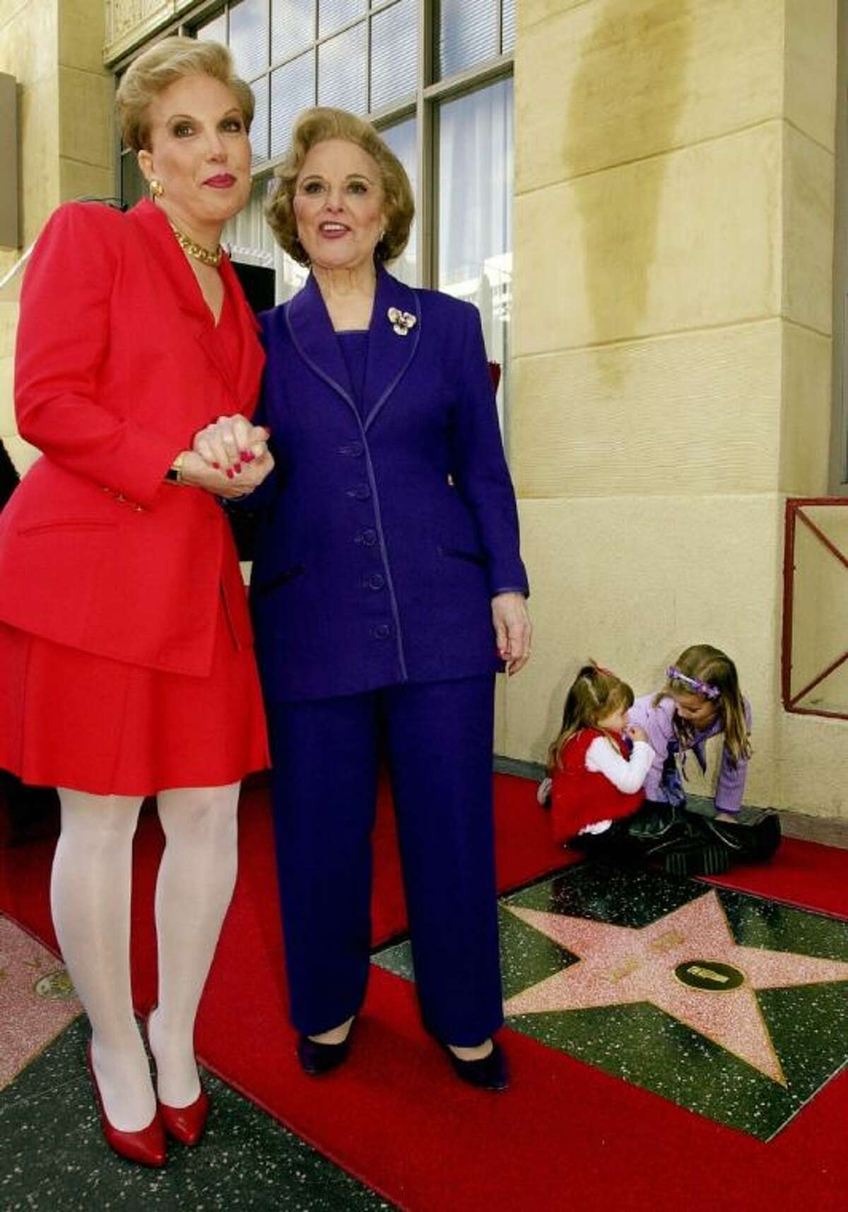 """In this Feb. 14, 2001 file photo, Pauline Friedman Phillips, right, the nationally-syndicated advice columnist best known as """"Dear Abby,"""" and her daughter Jeanne Phillips, pose after the dedication of a Dear Abby star on the Hollywood Walk of Fame in Los Angeles. Phillips, who had Alzheimer's disease, died Wednesday."""