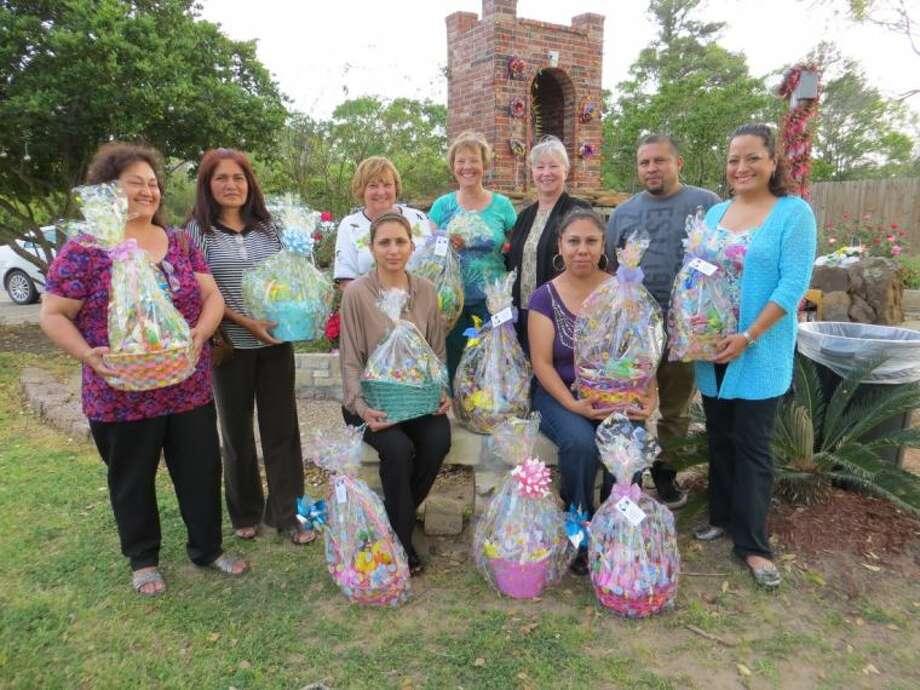 Left to right, Yolanda Castillo, Rosa Cervantes, Sharon O'Neil, Karen Darcy Pawlak, Betsy Moore, Leno Reyes, Maria Banos Jordan, Gabriella Gonzalez, and Susan Reyes