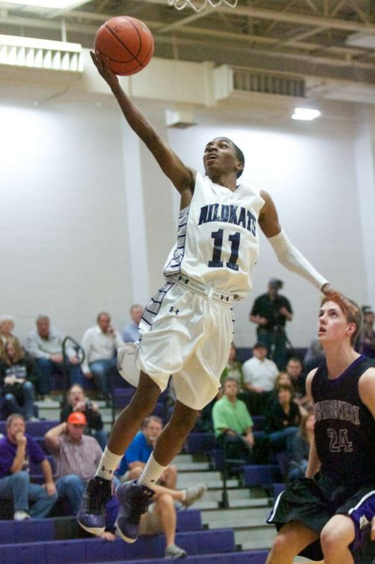 Willis' Keeton Fowler goes up for a basket during Friday night's game against Montgomery at Willis High School.