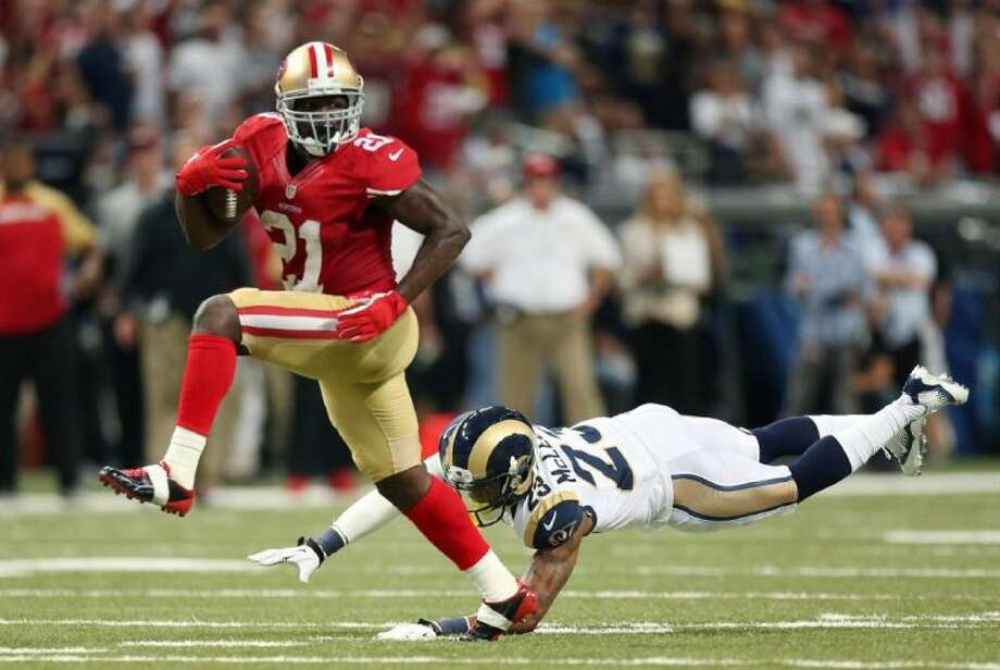 San Francisco 49ers running back Frank Gore eludes St. Louis Rams safety Rodney McLeod en route to a 34-yard touchdown run in the second quarter on Sept. 26 at the Edward Jones Dome in St. Louis. Photo: Chris Lee